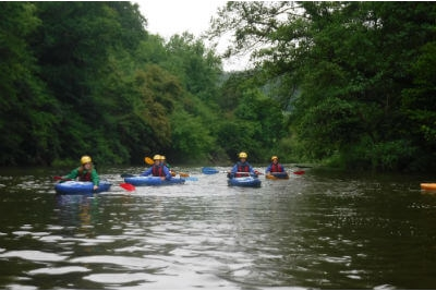 Kayaking on the Symonds Yat rapids on the River Wye, Wye Valley & Forest of Dean