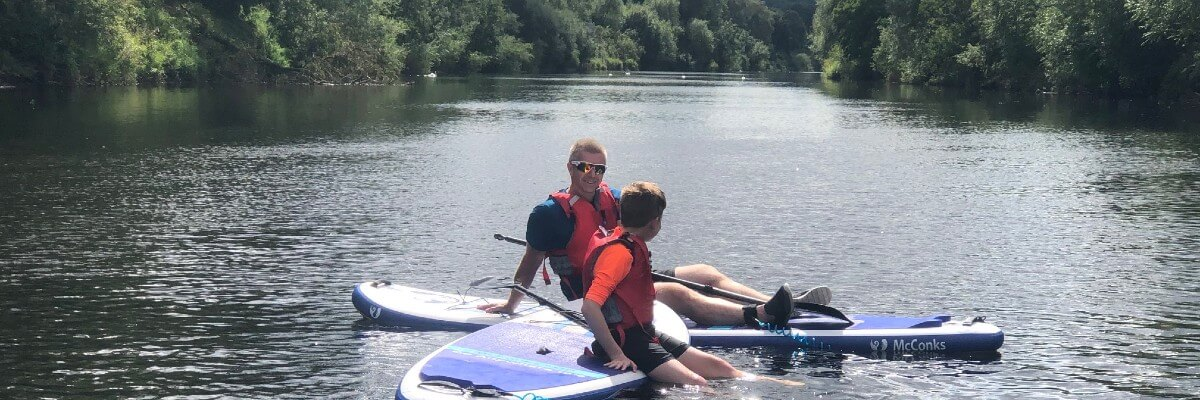 Stand-up paddle boarding on the River Wye Monmouth Forest of Dean